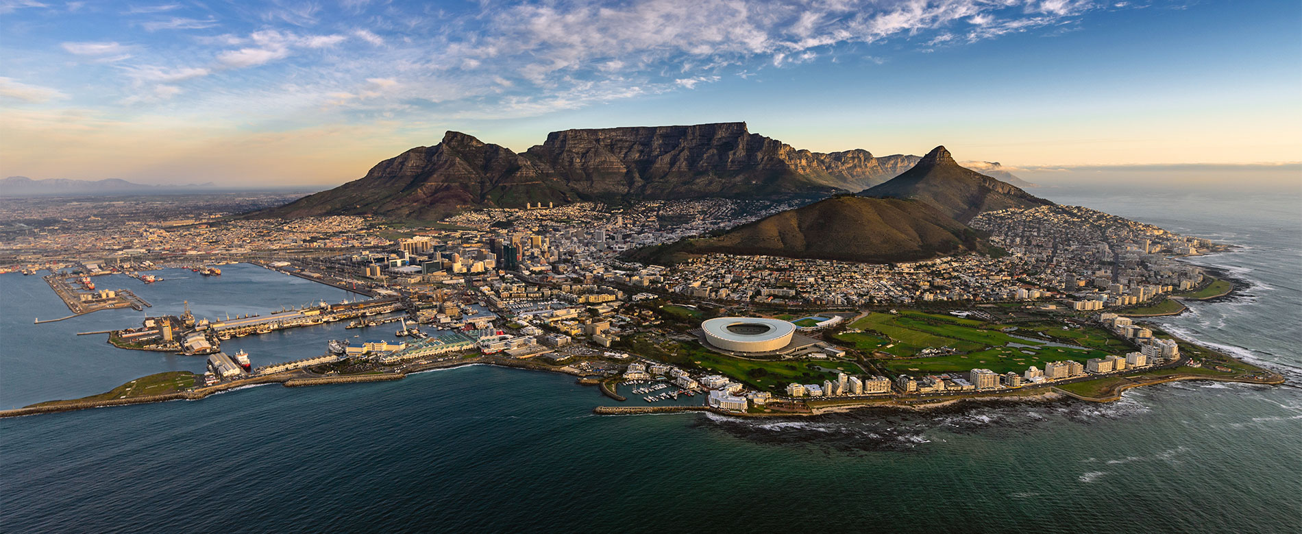 an image of table mountain surrounded by the ocean